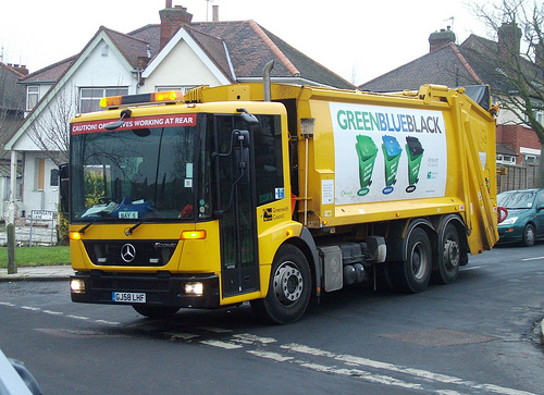garbage truck by Flickr user kenjonbro